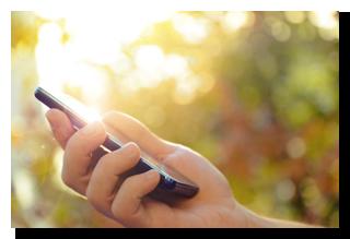 bigstock-Man-s-hand-using-mobile-smart--53439169-smaller